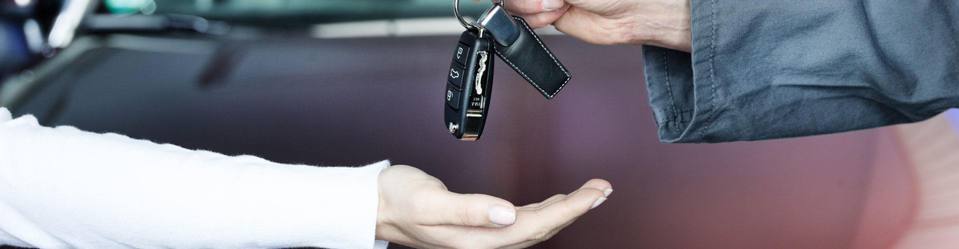Mechanic returning key to customer